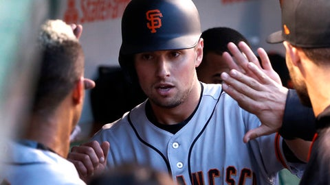 San Francisco Giants' Joe Panik celebrates in the dugout after scoring on a single by Brandon Belt during the third inning of a baseball game against the Chicago Cubs, Monday, May 22, 2017, in Chicago. (AP Photo/Charles Rex Arbogast)