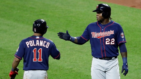Minnesota Twins' Miguel Sano, right, high-fives teammate Jorge Polanco after scoring on a sacrifice fly ball that was hit by Eduardo Escobar in the fifth inning of a baseball game against the Baltimore Orioles in Baltimore, Monday, May 22, 2017. (AP Photo/Patrick Semansky)