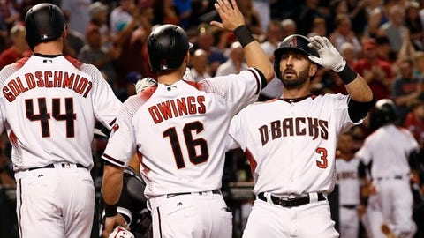 Arizona Diamondbacks' Daniel Descalso (3) celebrates his three-run home run against the Chicago White Sox with Chris Owings (16) and Paul Goldschmidt (44) during the fourth inning of a baseball game, Monday, May 22, 2017, in Phoenix. (AP Photo/Ross D. Franklin)