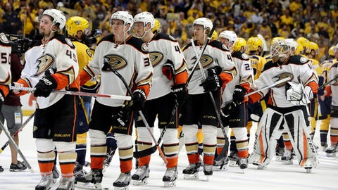 The Anaheim Ducks shake hands with the Nashville Predators after the Predators won Game 6 of the Western Conference final in the NHL hockey Stanley Cup playoffs Monday, May 22, 2017, in Nashville, Tenn. The Predators won 6-3 to win the series 4-2 and advance to the Stanley Cup Finals. (AP Photo/Mark Humphrey)