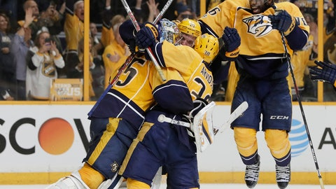 Nashville Predators players including defenseman P.K. Subban, right, celebrate with goalie Pekka Rinne, of Finland, left, after winning Game 6 of the Western Conference final against the Anaheim Ducks in the NHL hockey Stanley Cup playoffs Monday, May 22, 2017, in Nashville, Tenn. (AP Photo/Mark Humphrey)