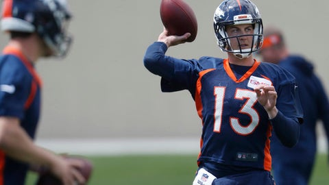 Denver Broncos quarterback Trevor Siemian throws during a drill at NFL football organized team activities at the team's headquarters Tuesday, May 23, 2017, in Englewood, Colo. (AP Photo/David Zalubowski)