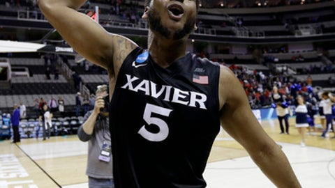 Xavier guard Trevon Bluiett (5) celebrates a win over Arizona during an NCAA Tournament college basketball regional semifinal game Thursday, March 23, 2017, in San Jose, Calif. (AP Photo/Ben Margot)