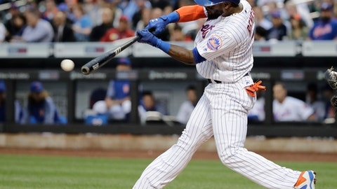 New York Mets' Jose Reyes hits a single during the first inning of a baseball game against the San Diego Padres, Tuesday, May 23, 2017, in New York. (AP Photo/Frank Franklin II)