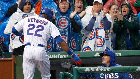 Chicago Cubs' Jason Heyward is greeted at the dugout by manager Joe Maddon after Heyward's home run off San Francisco Giants starting pitcher Johnny Cueto during the second inning of a baseball game Tuesday, May 23, 2017, in Chicago. (AP Photo/Charles Rex Arbogast)