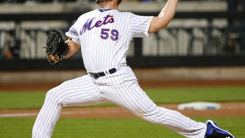 FILE - In this Saturday, Aug. 27, 2016 file photo, New York Mets relief pitcher Josh Smoker (59) delivers in the ninth inning of a baseball game against the Philadelphia Phillies in New York. Searching for answers in a wobbly bullpen, the New York Mets optioned struggling right-hander Hansel Robles to Triple-A Las Vegas on Tuesday, May 23, 2017 and recalled lefty Josh Smoker from their top farm club. (AP Photo/Kathy Willens, File)
