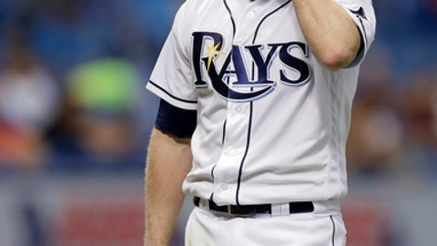 Tampa Bay Rays starting pitcher Alex Cobb wipes his forehead as he is taken out of the game against the Los Angeles Angels during the eighth inning of a baseball game Tuesday, May 23, 2017, in St. Petersburg, Fla. (AP Photo/Chris O'Meara)