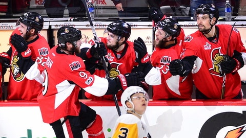 Ottawa Senators right wing Bobby Ryan (9) celebrates his goal with teammates as Pittsburgh Penguins defenseman Olli Maatta (3) watches the replay on the scoreboard during the second period of game six of the Eastern Conference final in the NHL Stanley Cup hockey playoffs in Ottawa on Tuesday, May 23, 2017. (Sean Kilpatrick/The Canadian Press via AP)