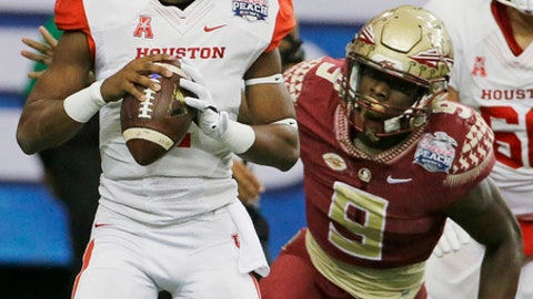 FILE -  In this Thursday, Dec. 31, 2015 file photo, Houston quarterback Greg Ward Jr. (1) looks for a receiver as Florida State defensive end Josh Sweat (9) moves into the pocket during the first half of the Peach Bowl NCAA college football game in Atlanta. Sweat was good as a freshman in 2015, making nine starts and registering five tackles for loss. Last season injuries delayed his progress, but he finished with seven sacks in his final seven games. With career sacks leader DeMarcus Walker gone, Sweat could turn into the Seminoles' most feared pass rusher. (AP Photo/David Goldman, File)