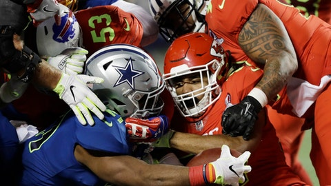 AFC special teamer D.J. Alexander (57), of the Kansas City Chiefs, center, and interior lineman Jurrell Casey (99), of the Tennessee Titans, stop NFC strong safety Landon Collins (21), of the New York Giants, short of the end zone, during the first half of the NFL Pro Bowl football game Sunday, Jan. 29, 2017, in Orlando, Fla. (AP Photo/Chris O'Meara)