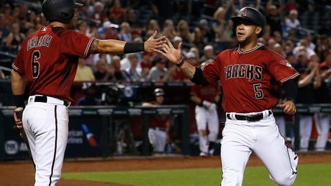 Arizona Diamondbacks' Gregor Blanco (5) celebrates his run scored against the Chicago White Sox with David Peralta (6) during the fifth inning of a baseball game, Wednesday, May 24, 2017, in Phoenix. (AP Photo/Ross D. Franklin)