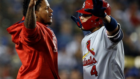 St. Louis Cardinals' Carlos Martinez, left, congratulates Yadier Molina, after Molina hit a solo home run during the seventh inning of a baseball game against the Los Angeles Dodgers in Los Angeles, Wednesday, May 24, 2017. (AP Photo/Alex Gallardo)
