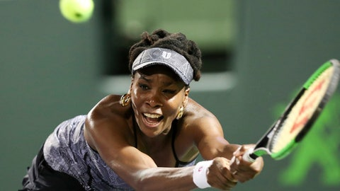 FILE - In this March 29, 2017, file photo, Venus Williams tries to return a shot against Angelique Kerber during a quarterfinal match at the Miami Open tennis tournament,  in Key Biscayne, Fla. Venus Williams will be competing in the French Open. (AP Photo/Mario Houben, File)