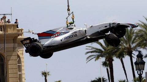 The car of Williams driver Lance Stroll of Canada is lifted after a crash during the second free practice during the Formula One Grand Prix at the Monaco racetrack in Monaco, Thursday, May 25, 2017. The Formula one race will be held on Sunday. (AP Photo/Claude Paris)