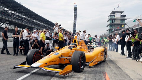 """FILE - In this May 20, 2017, file photo, Fernando Alonso, of Spain, pulls out of the pits during qualifications for the Indianapolis 500 IndyCar auto race at Indianapolis Motor Speedway, in Indianapolis. A year after the biggest celebration in the history of the Indianapolis 500, much of the buzz around the 101st running of the race involves the debut of a well-decorated """"rookie"""": Two-time Formula One champion Fernando Alonso. (AP Photo/Darron Cummings, File)"""