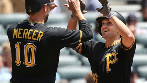 Pittsburgh Pirates' Adam Frazier is congratulated by Jordy Mercer after hitting a three-run home run against the Atlanta Braves during the second inning of a  baseball game on Thursday, May 25, 2017, in Atlanta. (Curtis Compton/Atlanta Journal-Constitution via AP)