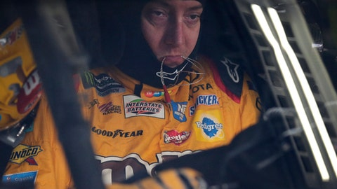 Kyle Busch waits in his car before practice for Sunday's NASCAR Cup series auto race at Charlotte Motor Speedway in Concord, N.C., Thursday, May 25, 2017. Busch won the All-Star race last weekend, his first Cup race win at Charlotte Motor Speedway ever. Now he turns to attention to winning a Cup points race on Sunday at the Coca-Cola 600. (AP Photo/Chuck Burton)