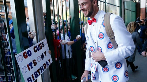 Chicago Cubs' Kris Bryant departs for the team's road trip wearing suits based on the character Ron Burgundy in the Anchor Man movie, after a baseball game against the San Francisco Giants Thursday, May 25, 2017, in Chicago. Bryant told reporters that this is the suit that Ellen DeGeneres gave him when he appeared on her show. (AP Photo/Charles Rex Arbogast)