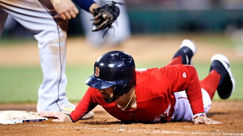 Boston Red Sox's Deven Marrero dives back to safely before a pick-off attempt tag by Seattle Mariners first baseman Danny Valencia during the fourth inning of a baseball game at Fenway Park in Boston, Friday, May 26, 2017. (AP Photo/Charles Krupa)