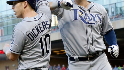 Tampa Bay Rays' Logan Morrison, right, and Corey Dickerson celebrate Morrison's two-run home run off Minnesota Twins pitcher Hector Santiago in the fourth inning of a baseball game Friday, May 26, 2017 in Minneapolis. (AP Photo/Jim Mone)