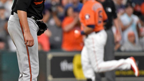 Baltimore Orioles starting pitcher Kevin Gausman, left, looks down as Houston Astros' Carlos Beltran, right, rounds the bases after hitting a solo home run during the sixth inning of a baseball game, Friday, May 26, 2017, in Houston. (AP Photo/Eric Christian Smith)