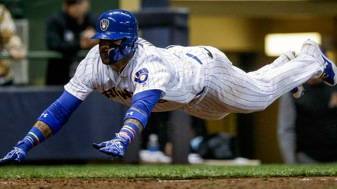 Milwaukee Brewers' Jonathan Villar drives home safely on a Hernan Perez RBI-single off Arizona Diamondbacks' Andrew Chafin during the eighth inning of a baseball game Friday, May 26, 2017, in Milwaukee. (AP Photo/Tom Lynn)