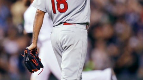 St. Louis Cardinals starting pitcher Carlos Martinez, front, reacts after giving up a solo home run to Colorado Rockies' Charlie Blackmon in the bottom of the eighth inning of a baseball game Friday, May 26, 2017, in Denver. (AP Photo/David Zalubowski)