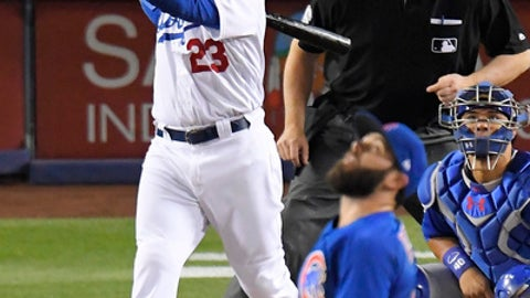 Los Angeles Dodgers' Adrian Gonzalez, left, hits a two-run home run as Chicago Cubs starting pitcher Jake Arrieta, below, watches along with catcher Willson Contreras, right, and home plate umpire Mike DiMuro during the sixth inning of a baseball game, Friday, May 26, 2017, in Los Angeles. (AP Photo/Mark J. Terrill)