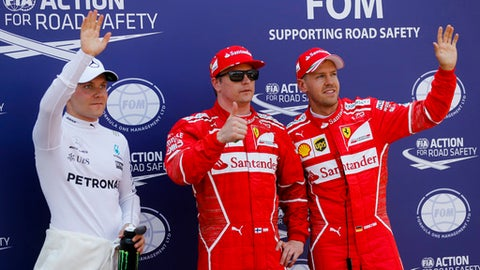From left, Mercedes driver Valtteri Bottas of Finland and the Ferrari drivers Kimi Raikkonen of Finland and Sebastian Vettel of Germany greet the crowd after the qualifying session for the Formula One Grand Prix at the Monaco racetrack in Monaco, Saturday, May 27, 2017. The Formula 1 Grand Prix of Monaco race will take place on Sunday May 28. (AP Photo/Frank Augstein)