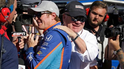Car owner Chip Ganassi congratulates driver Scott Dixon, of New Zealand, after he won the pole during qualifications for the Indianapolis 500 IndyCar auto race at Indianapolis Motor Speedway, Sunday, May 21, 2017 in Indianapolis. (AP Photo/Michael Conroy)