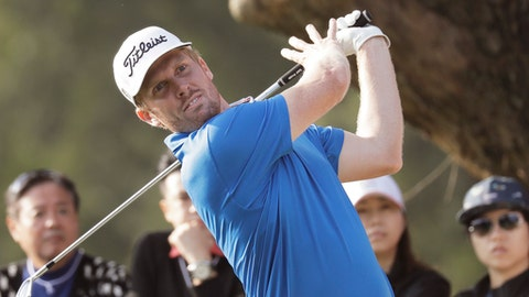 Andrew Dodt of Australia tees off on the 18th hole at the Hong Kong Open golf tournament in Hong Kong, Sunday, Dec. 11, 2016. Australia's Sam Brazel birdied the 18th hole to narrowly edge Rafa Cabrera Bello to capture the Hong Kong Open on Sunday, his first title on the European Tour. (AP Photo/Kin Cheung)