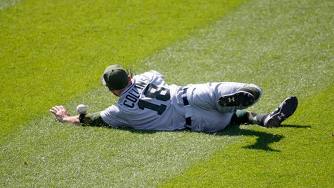 Detroit Tigers' Tyler Collins is unable to catch an RBI-single by Chicago White Sox's Jose Abreu, scoring Leury Garcia, during the eighth inning of a baseball game Saturday, May 27, 2017, in Chicago. (AP Photo/Charles Rex Arbogast)
