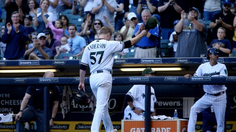 MILWAUKEE, WI - MAY 27:  Chase Anderson #57 of the Milwaukee Brewers acknowledges the crowd after being relieved in the eighth inning against the Arizona Diamondbacks at Miller Park on May 27, 2017 in Milwaukee, Wisconsin. (Photo by Dylan Buell/Getty Images)