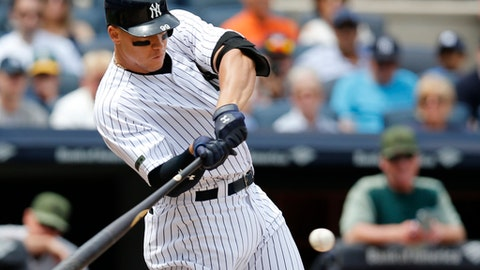 New York Yankees Aaron Judge hits a grand slam during the third inning of a baseball game against the Oakland Athletics in New York, Sunday, May 28, 2017. (AP Photo/Kathy Willens)