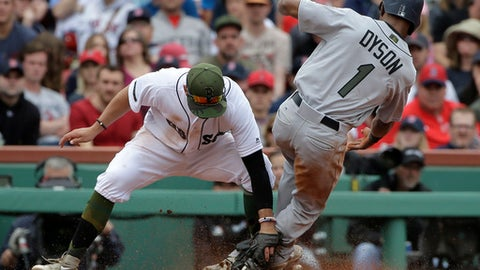 Seattle Mariners' Jarrod Dyson (1) slides out while attempting to steal third base as Boston Red Sox's Deven Marrero, left, makes the tag in the eighth inning of a baseball game, Sunday, May 28, 2017, in Boston. (AP Photo/Steven Senne)