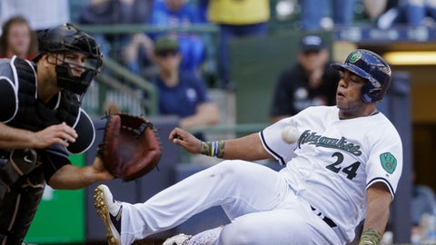 Milwaukee Brewers' Jesus Aguilar, right, scores ahead of the tag by Arizona Diamondbacks' Chris Ianetta, left, during the sixth inning of a baseball game Sunday, May 28, 2017, in Milwaukee. (AP Photo/Jeffrey Phelps)