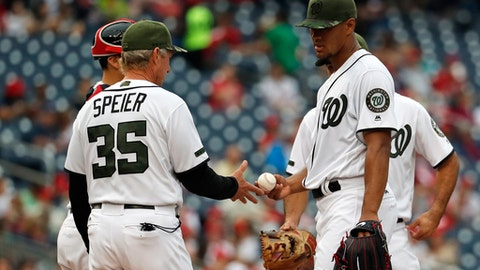 Washington Nationals bench coach Chris Speier (35), who is filling in for manager Dusty Baker, relieves starting pitcher Joe Ross during the fifth inning of a baseball game against the San Diego Padres at Nationals Park, Sunday, May 28, 2017, in Washington. Baker is missing the weekend series to attend his son's high school graduation. (AP Photo/Alex Brandon)