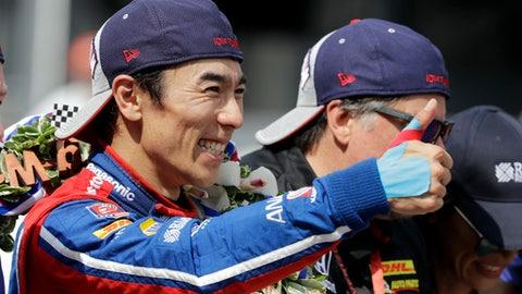 Takuma Sato, of Japan, celebrates on the Yard of Bricks on the start/finish line after winning the Indianapolis 500 auto race at Indianapolis Motor Speedway, Sunday, May 28, 2017 in Indianapolis.(AP Photo/Darron Cummings)