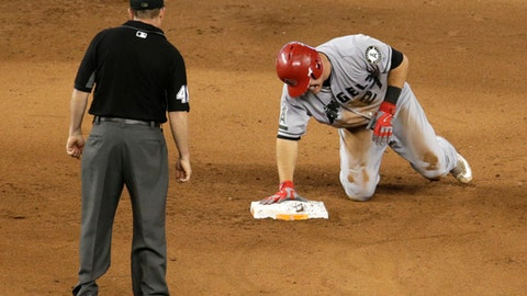 Los Angeles Angels' Mike Trout grimaces after stealing second during the fifth inning of an interleague baseball game against the Miami Marlins, Sunday, May 28, 2017, in Miami. Trout injured his thumb on the play. (AP Photo/Lynne Sladky)