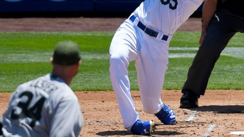 Los Angeles Dodgers' Cody Bellinger, right, hits a three-run home run as Chicago Cubs starting pitcher Jon Lester watches during the second inning of a baseball game, Sunday, May 28, 2017, in Los Angeles. (AP Photo/Mark J. Terrill)