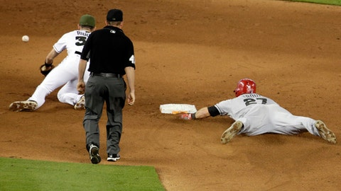 Mike Trout sprains thumb on headfirst slide; Angels say X-rays negative