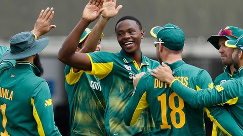 South Africa's bowler Kagiso Rabada centre celebrates taking the wicket of England's Adil Rashid during the third One Day International cricket match between England and South Africa at Lord's cricket ground in London Monday