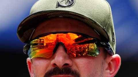 Coors Field is reflected in the sunglasses of Seattle Mariners relief pitcher Nick Vincent as he heads to the bullpen as the Mariners face the Colorado Rockies in the first inning of an interleague baseball game Monday, May 29, 2017, in Denver. (AP Photo/David Zalubowski)