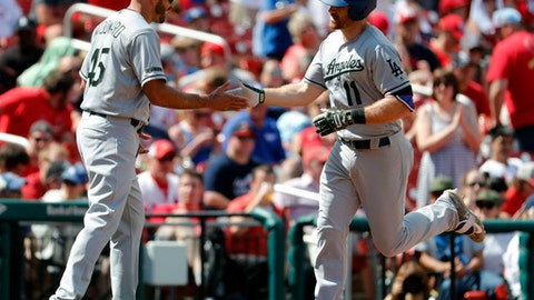 Los Angeles Dodgers' Logan Forsythe (11) is congratulated by third base coach Chris Woodward after hitting a solo home run during the eights inning of a baseball game against the St. Louis Cardinals, Monday, May 29, 2017, in St. Louis. (AP Photo/Jeff Roberson)