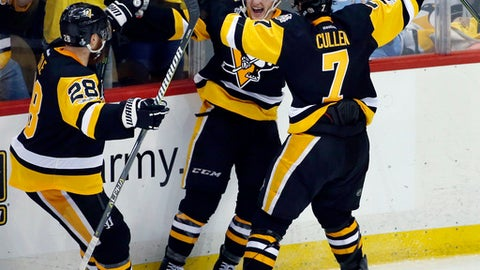 Pittsburgh Penguins' Jake Guentzel, center, celebrates his goal against the Nashville Predators with Ian Cole, left, and Matt Cullen during the third period in Game 1 of the NHL hockey Stanley Cup Finals, Monday, May 29, 2017, in Pittsburgh. (AP Photo/Gene J. Puskar)