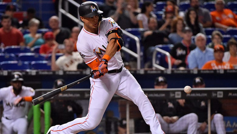 Marlins open 10 game home stand with a win behind Stanton, Bour HR's
