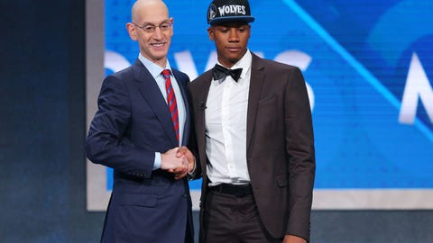 Jun 23, 2016; New York, NY, USA; Kris Dunn (Providence) greets NBA commissioner Adam Silver  after being selected as the number five overall pick to the Minnesota Timberwolves in the first round of the 2016 NBA Draft at Barclays Center. Mandatory Credit: Brad Penner-USA TODAY Sports