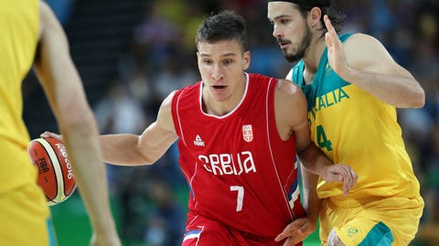 Aug 19, 2016; Rio de Janeiro, Brazil;  Serbia shooting guard Bogdan Bogdanovic (7) drives to the basket against Australia shooting guard Chris Goulding (4) during the men's basketball semifinal in the Rio 2016 Summer Olympic Games at Carioca Arena 1. Mandatory Credit: Jeff Swinger-USA TODAY Sports