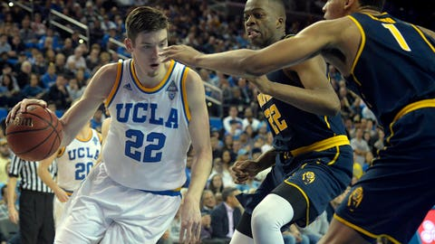 January 5, 2017; Los Angeles, CA, USA;  UCLA Bruins forward TJ Leaf (22) moves the ball against the defense of California Golden Bears center Kingsley Okoroh (22) and forward Ivan Rabb (1) during the second half at Pauley Pavilion. Mandatory Credit: Gary A. Vasquez-USA TODAY Sports