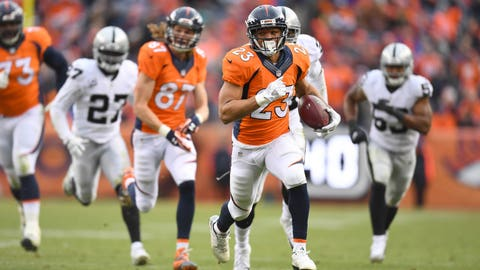 Jan 1, 2017; Denver, CO, USA; Denver Broncos running back Devontae Booker (23) carries the ball for touchdown in the first half against the Oakland Raiders at Sports Authority Field. Mandatory Credit: Ron Chenoy-USA TODAY Sports